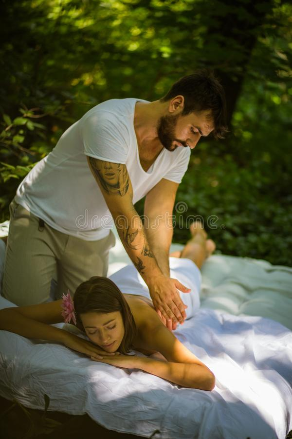 Men massage women at nature. Time for relax royalty free stock images