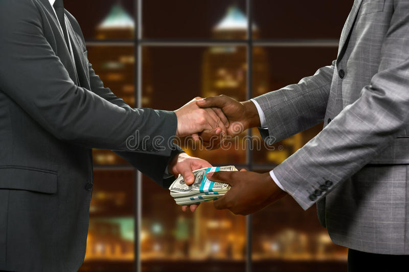 Men organize deal at office. stock photography