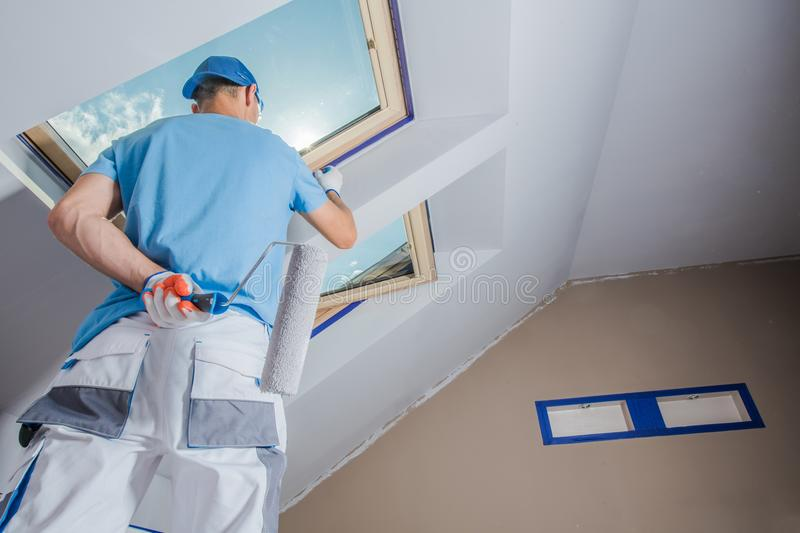 Men Painting Apartment. Caucasian Men Painting His Apartment. Construction Theme royalty free stock photo