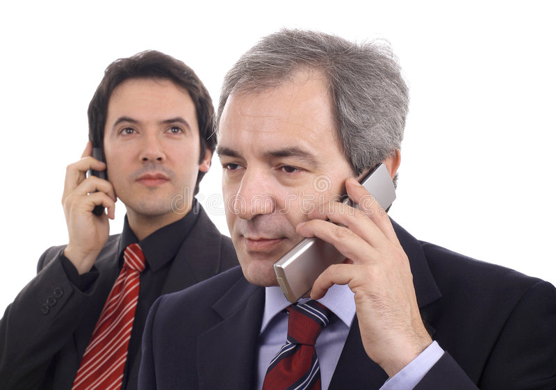 Men on the phone. Men talking on the phone isolated over white royalty free stock photos
