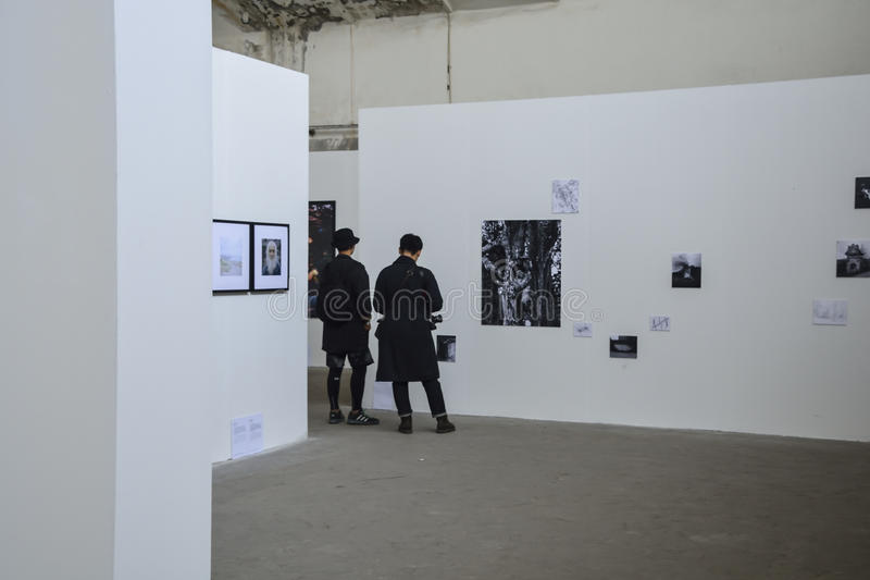 Men and photography on the white walls stock photography