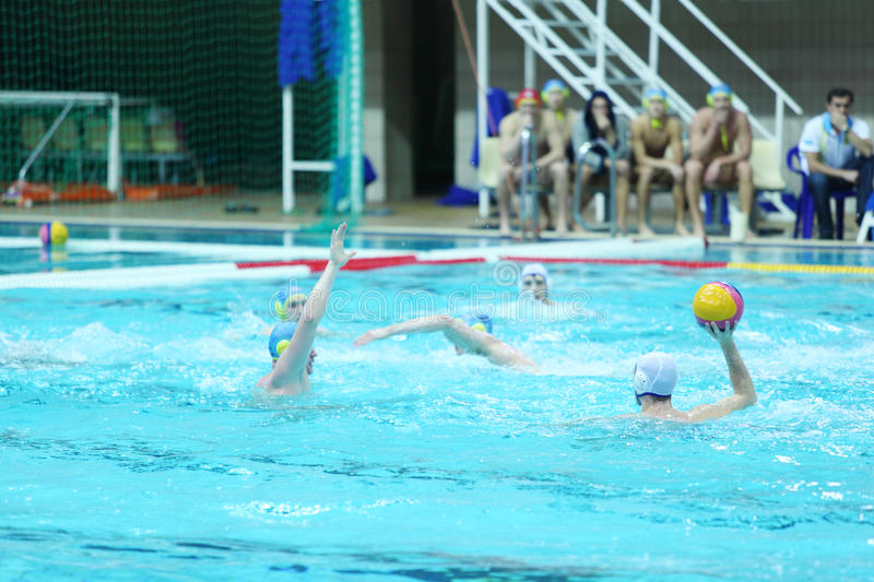 Men play water polo in pool. MOSCOW - MARCH 3: Men play water polo in pool, spectators, judge watch match at 7th round match of Russian Championship in water royalty free stock photos