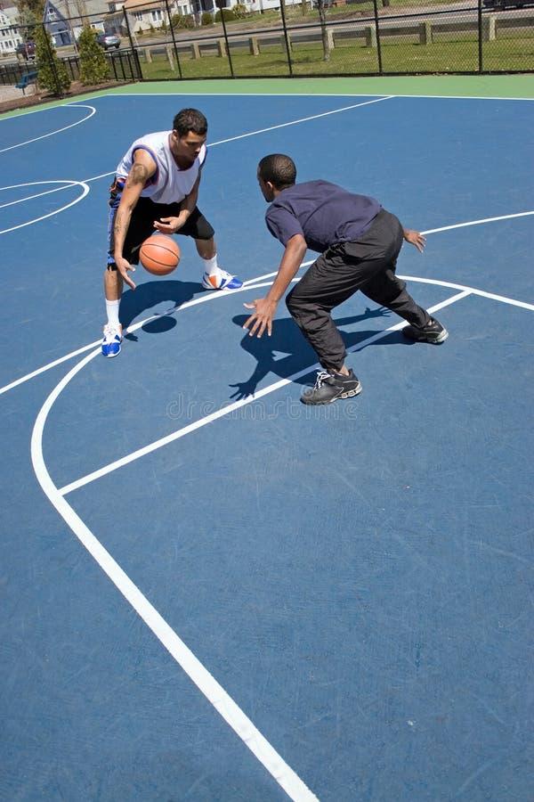 Men Playing Basketball royalty free stock photos