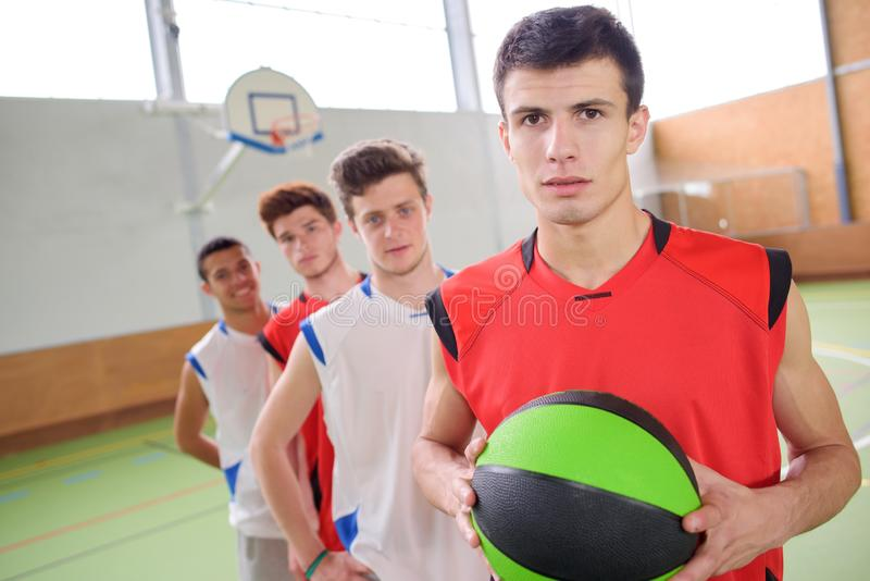Men playing basketball game stock photos