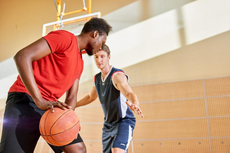 Men playing basketball together royalty free stock photo
