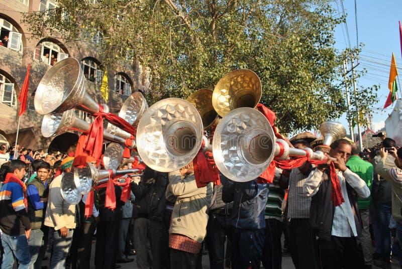 Men Playing Brass Trumpet - Karnal, Himachal folk music. Men Playing the Karnal during a celebratory procession at Mandi, Himachal stock image