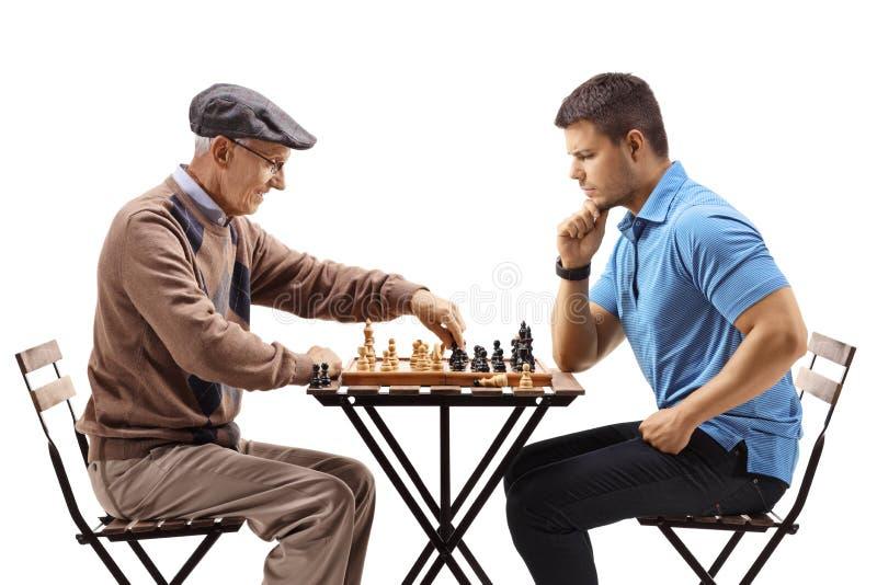 Men playing chess royalty free stock photos