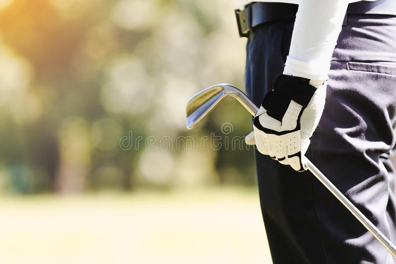 Men playing golf stock photography