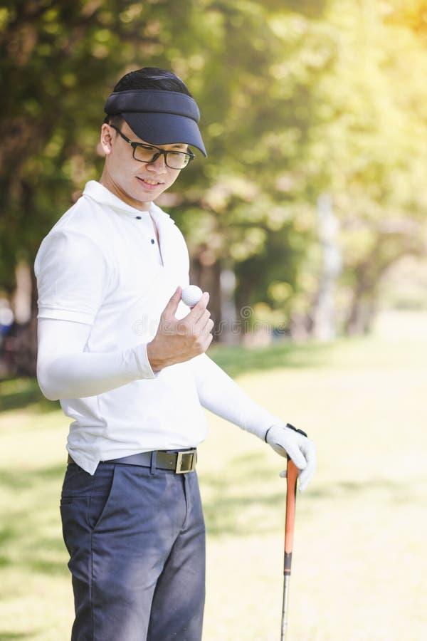 Men playing golf stock photo