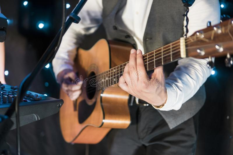 Men is playing the guitar on the concert. Men is playing the guitar on the concert stock image