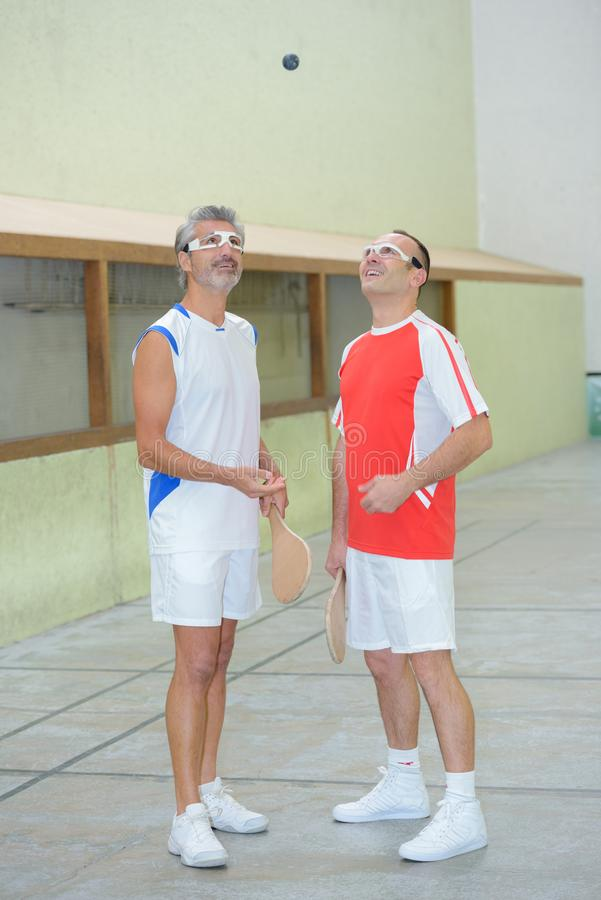 Men playing paddle ready to touch ball royalty free stock photography