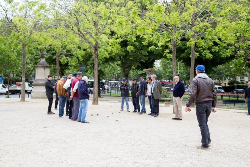 Men playing Petanque in Paris, France stock photos