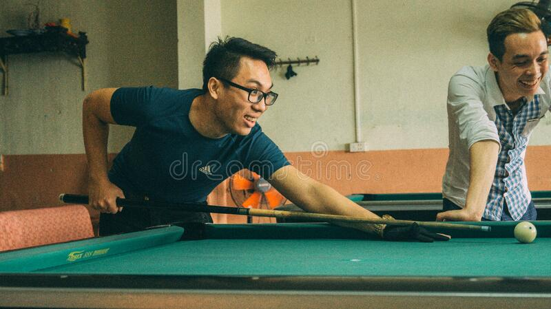 Men playing pool stock photo