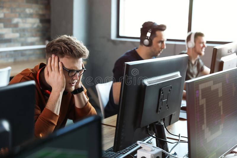 Men playing video games in stock images