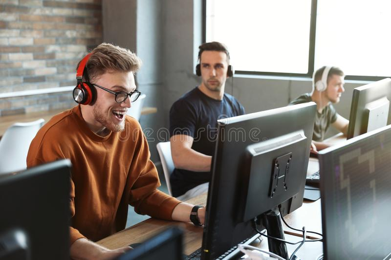 Men playing video games in cafe stock photos