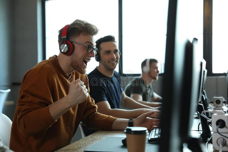 Men playing video games in internet royalty free stock image