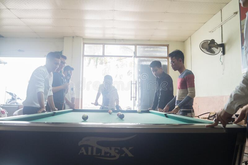 Men in pool hall royalty free stock image