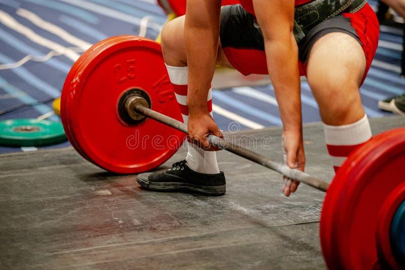 men powerlifter start attempt deadlift stock photos