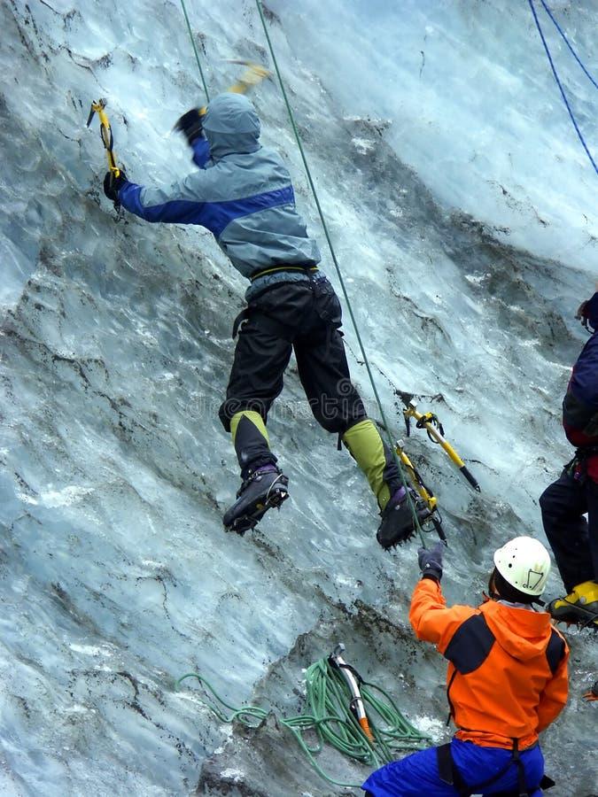 Men practising to climb glacier stock images