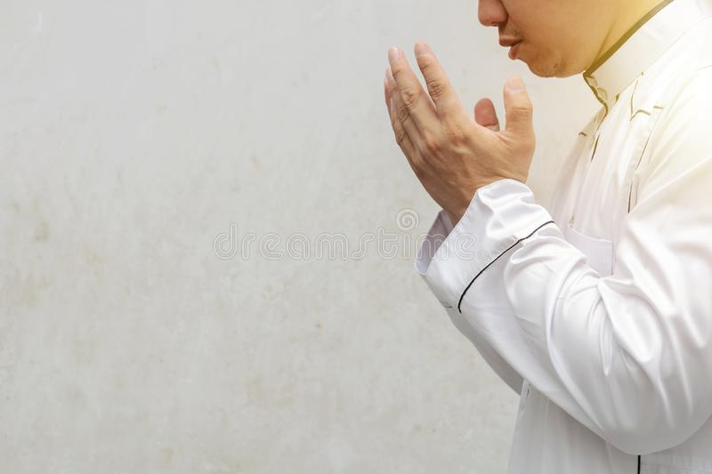 Men are praying their God Of Islam. stock photo