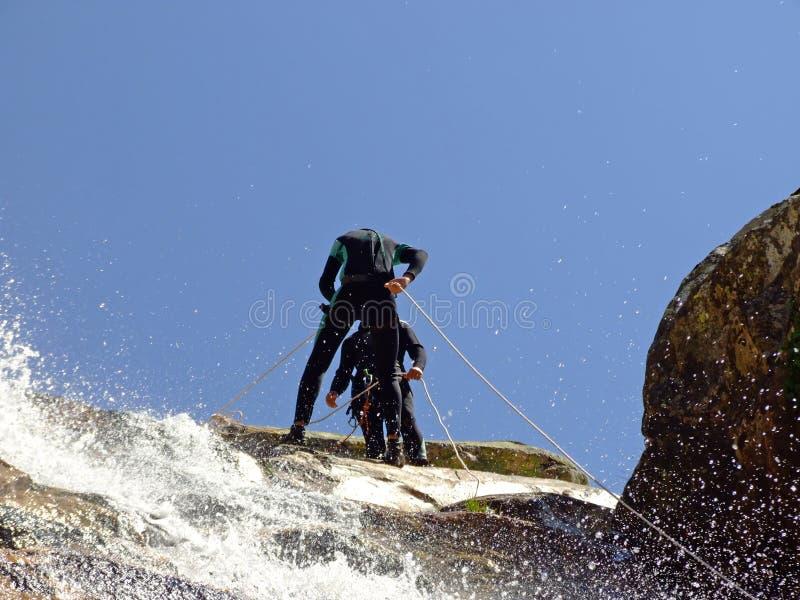 Men preparing to descend