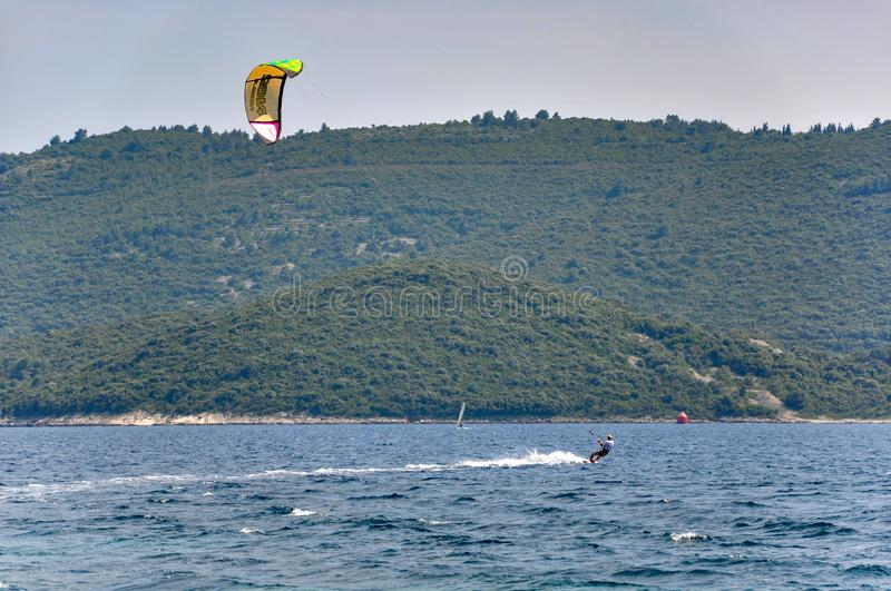 Men pursuing watersports in the sea off Viganj royalty free stock images