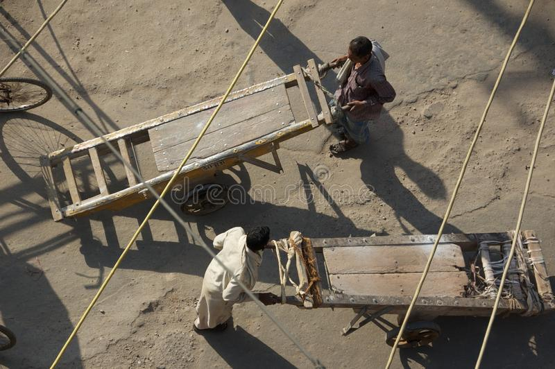 Download Men Pushing Wooden Carts On Dusty Market Square - Stock Photo Editorial Photography - Image: 39409017