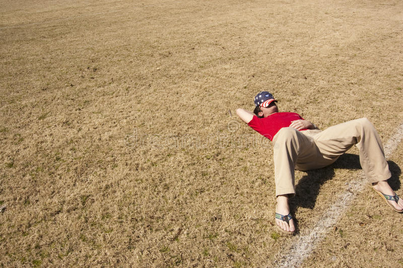 Download Men In Red Shirt Lying On A Brown Ground During Daytime Stock Image - Image of sports, field: 82987893