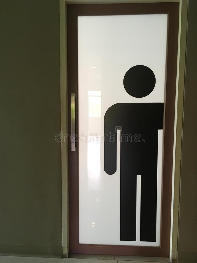 Men Restroom symbol on the door stock images