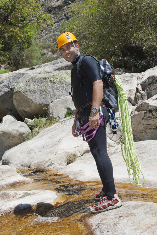 Men In River With Equipment To Canyoning Stock Photography