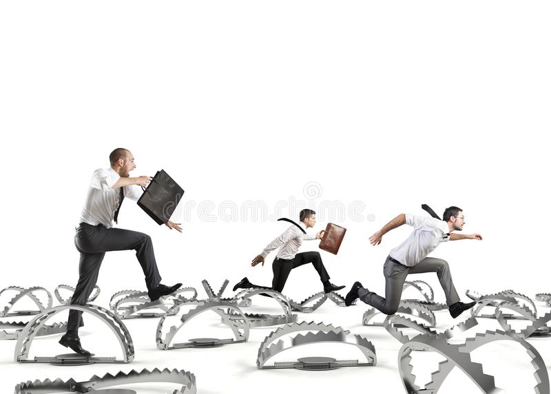 Men run in a thousand difficulties. Man falls into trap during a competition. Concept of difficulty in life and work stock photos