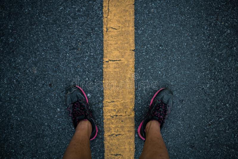 Men runner feet on road in workout wellness. Men runner feet on road in workout wellness concept royalty free stock photos