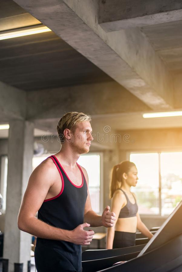 Man running on treadmill doing cardio training in sport club,Healthy lifestyle concept. Men running on treadmill doing cardio training in sport club,Healthy royalty free stock images