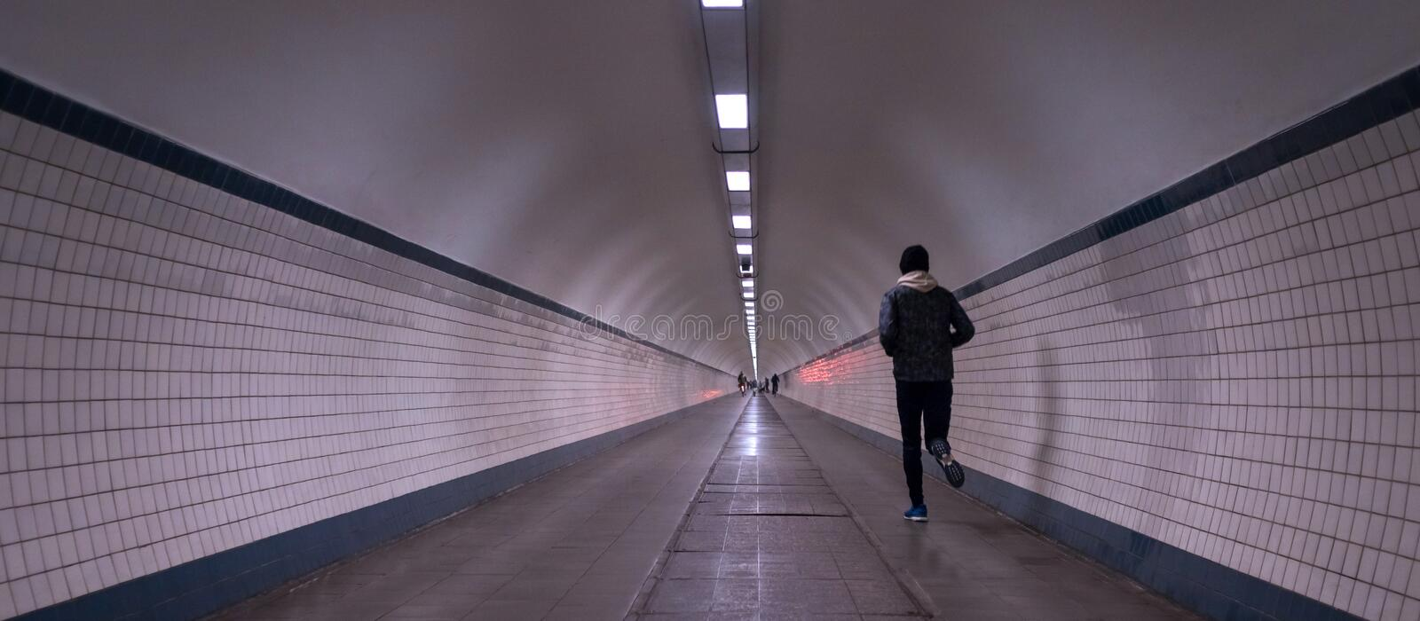 Men running in an tunnel royalty free stock photos