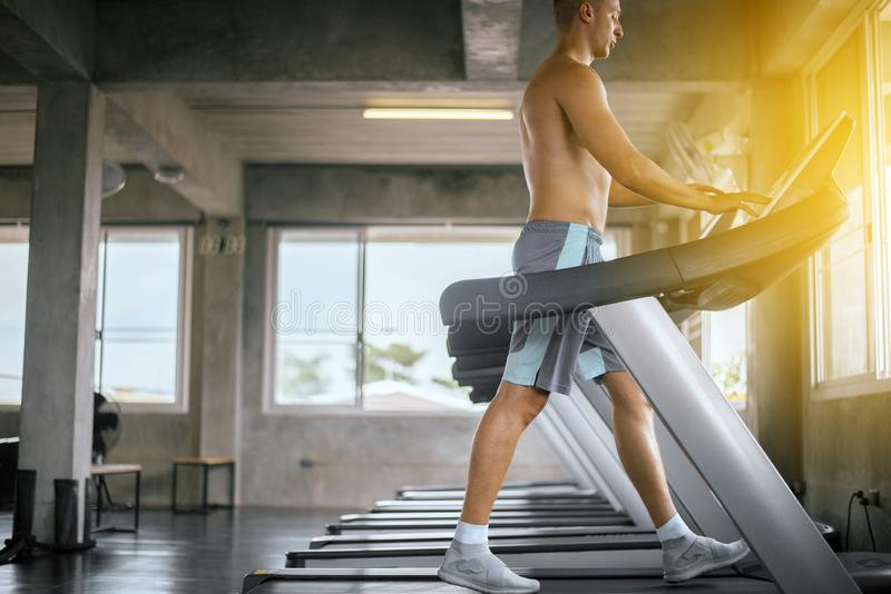 Man running with using function on treadmill doing cardio training in sport club,Concept healthy and lifestyle stock photos