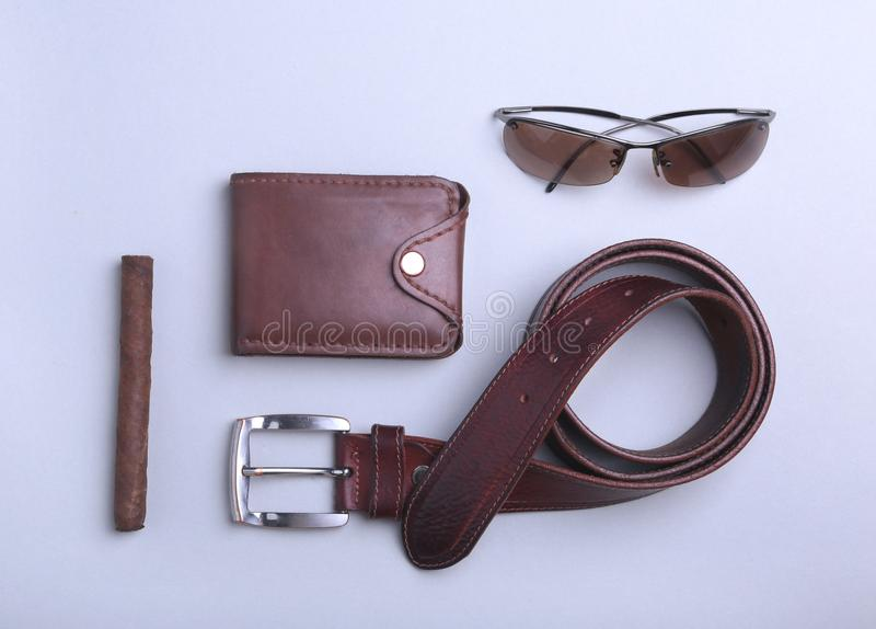 Men`s accessories for business and recreation. Wallet, belt, glasses, cigar. Top view composition. Men`s accessories for business and recreation. Wallet, belt royalty free stock images