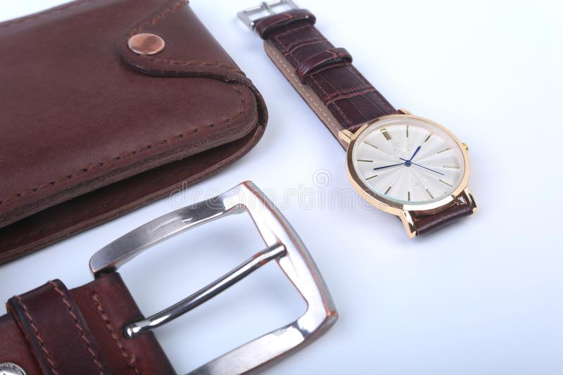 Men`s accessories for business and rekreation. Leather belt, wallet, watch and smoking pipe on white background.. Top. View composition royalty free stock photography