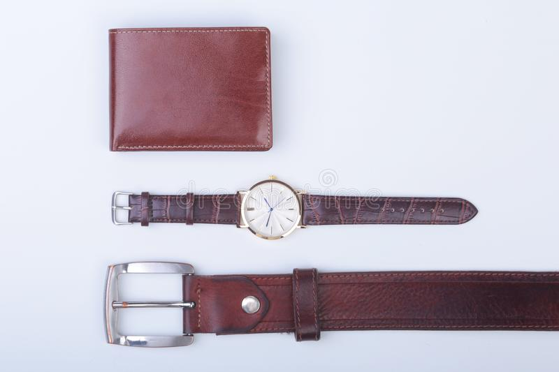 Men`s accessories for business and rekreation. Leather belt, wallet, watch and smoking pipe on white background.. Top. View composition royalty free stock images