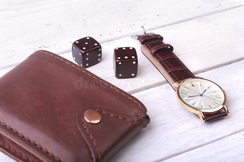 Men`s accessories for business and rekreation. Leather belt, wallet, watch and smoking pipe on wood background.. Top. View composition royalty free stock photo
