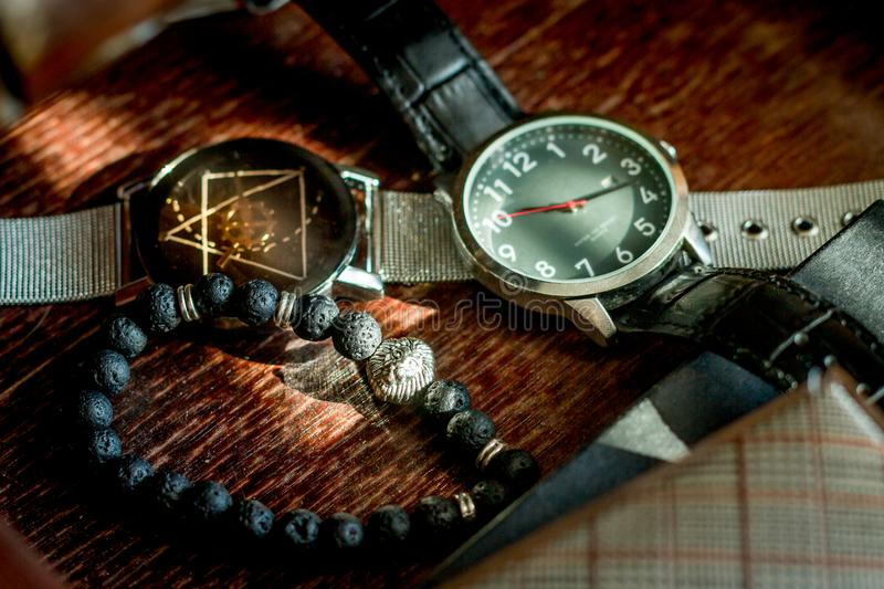 Men`s Accessories in drawer. Men`s Time pieces and Accessories in drawer with natural spotlight stock photography