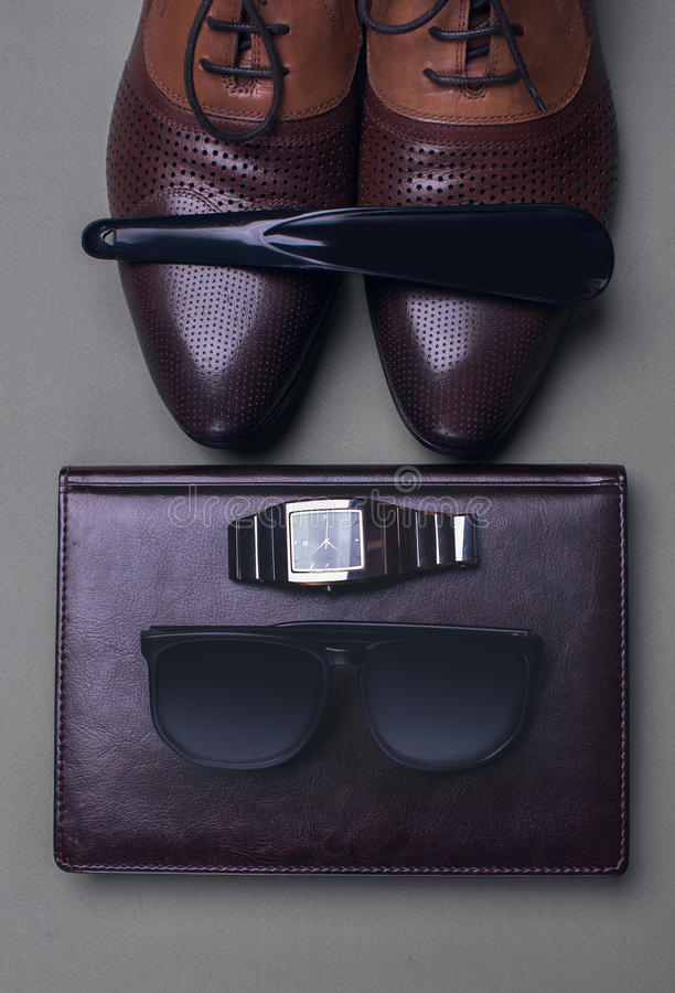 Men's accessories. Shoes and sunglasses royalty free stock photos