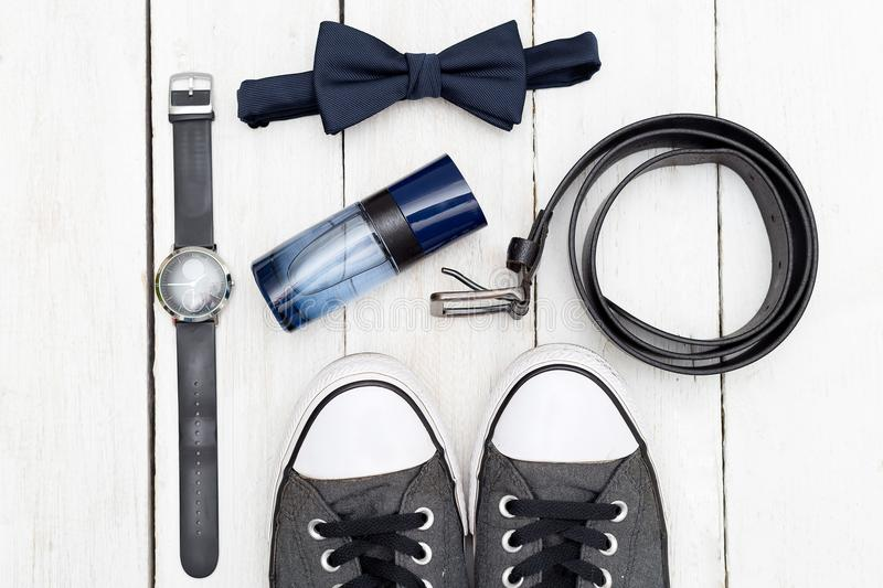 Men`s accessories and shoes on a wooden background. Flat lay royalty free stock image