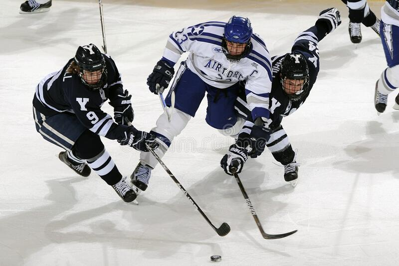 Men's in Blue and White Jersey Shirt Playing Hockey stock photography