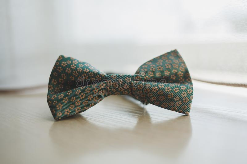 Men`s bow tie on a wooden background stock image