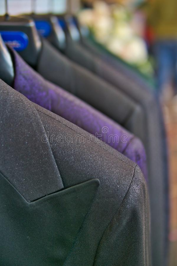 Men`s cardigan and shirt on shopping retail store. Shop and sale concept royalty free stock photos