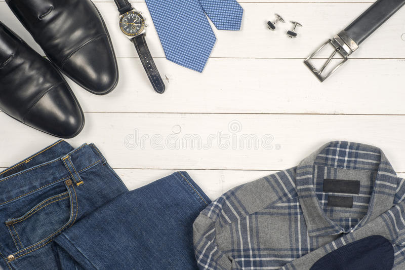 Men's casual clothes and accessories on wooden background royalty free stock images