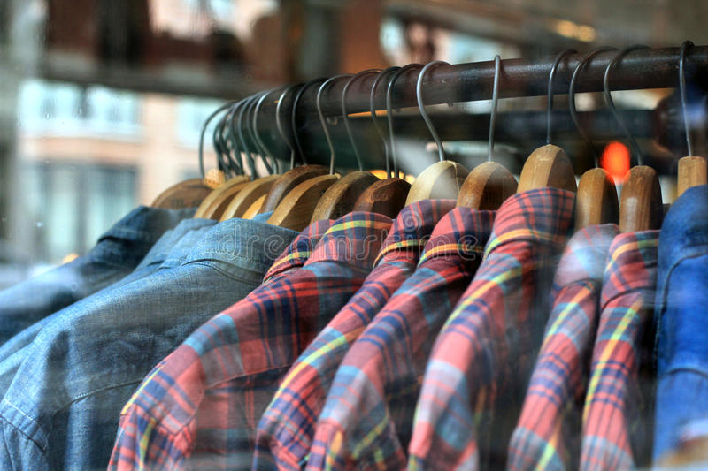 Men`s Clothing. Hanging in a store display stock image