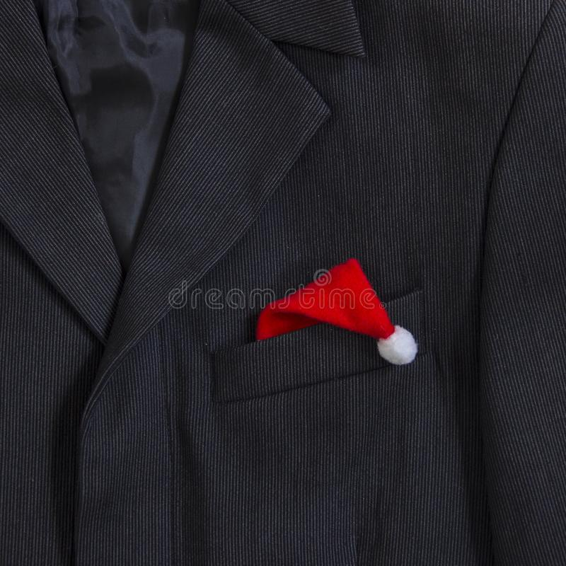 Men`s dark jacket in small stripes collar pocket sleeve in the pocket cap Santa Claus cap square stock images