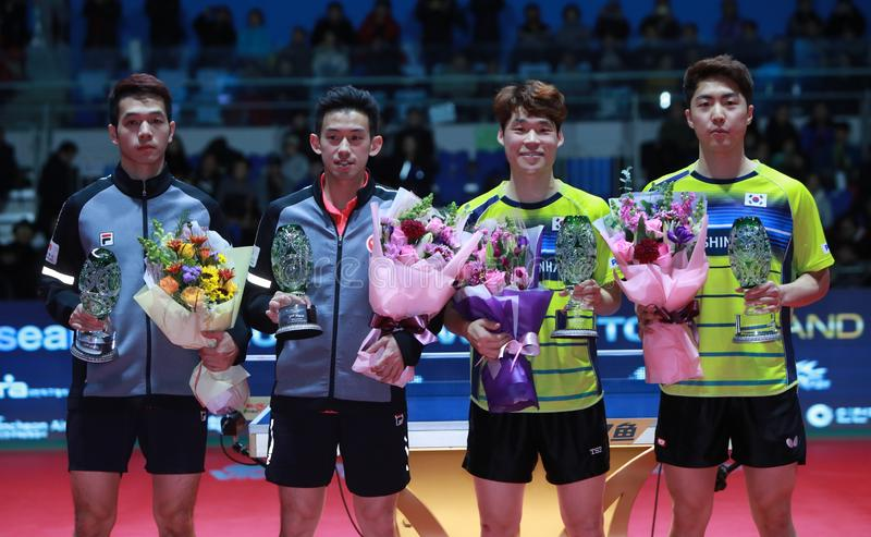 Men`s Doubles Awards. Men`s Doubles - Finals - Gold Medal Match, JANG Woojin KOR and LIM Jonghoon KOR beat HO Kwan Kit HKG and WONG Chun Ting HKG 3/2. 2018 Pro royalty free stock photography