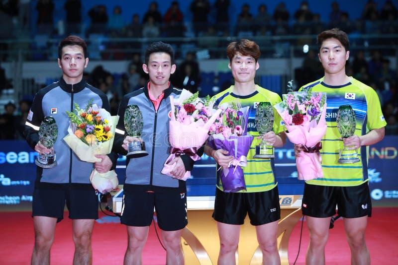 Men`s Doubles Awards. Men`s Doubles - Finals - Gold Medal Match, JANG Woojin KOR and LIM Jonghoon KOR beat HO Kwan Kit HKG and WONG Chun Ting HKG 3/2. 2018 Pro royalty free stock images
